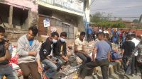 People waiting outside in the immediate aftermath of the earthquake. Nepal.; }}