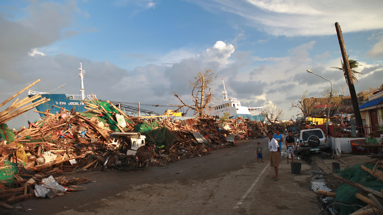 Destruction caused by typhoon Haiyan in November 2013.; }}