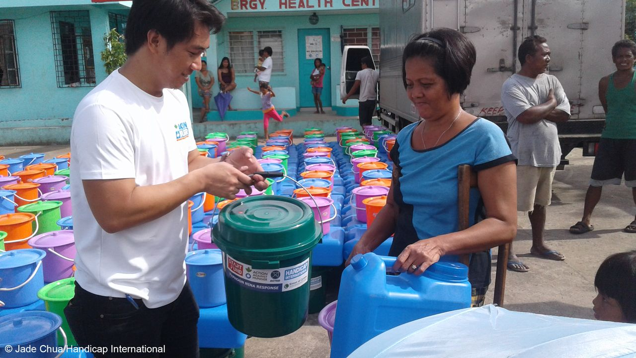 Distribution of hygiene & shelter kits organized by Handicap International and its partners, with Start Fund support, to population affected by Typhoon Nock Ten.; }}