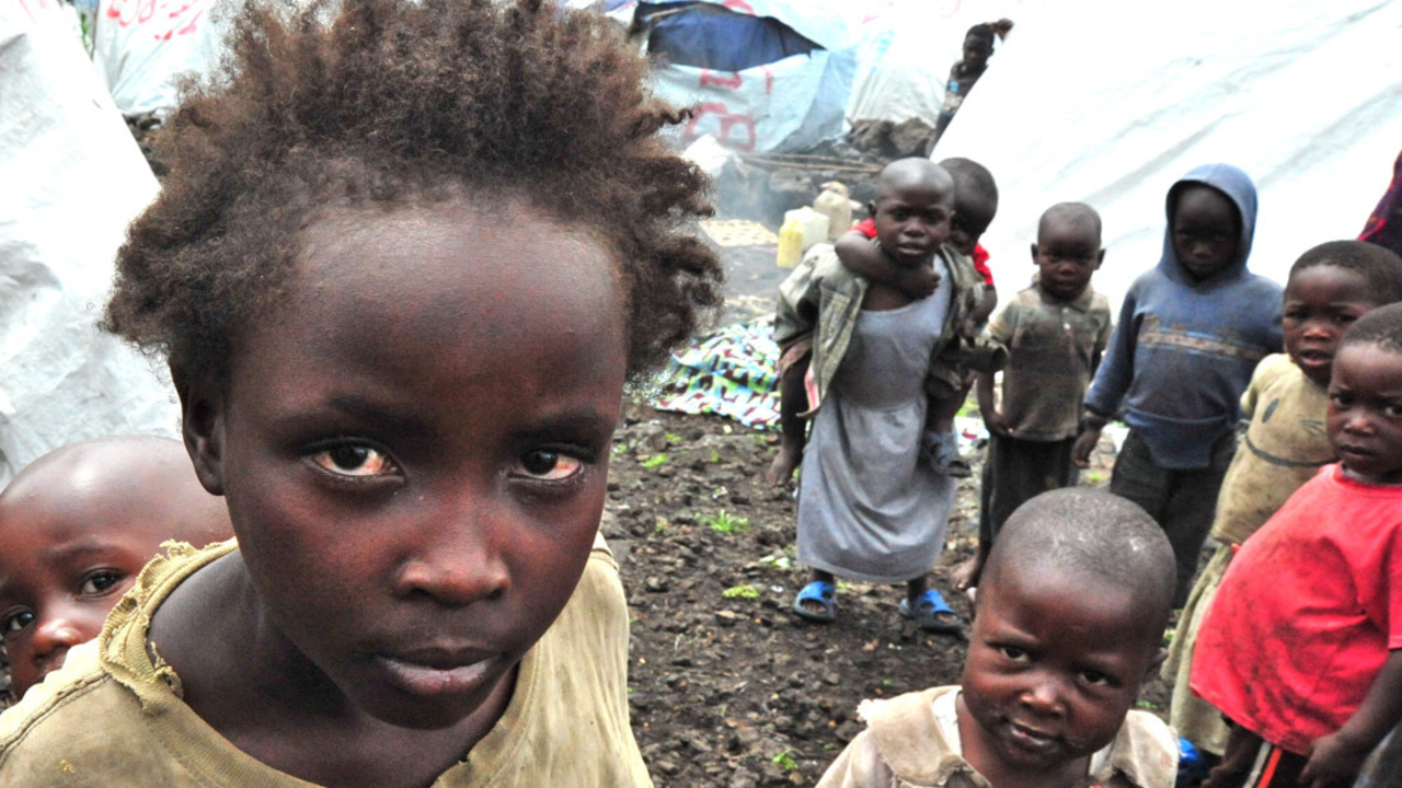 Group of children in Mugunga 3 camp near Goma (photo archive – 2013); }}