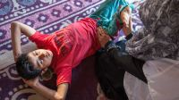 Sahil, 10 years old, doing a rehabilitation session at home in Kashmir.; }}