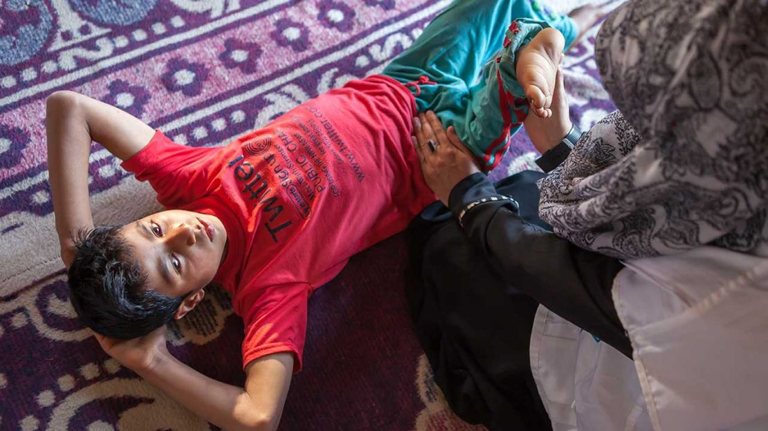 Sahil, 10 years old, doing a rehabilitation session at home in Kashmir.