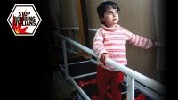 Malak, 5, using parallel bars, Jordan