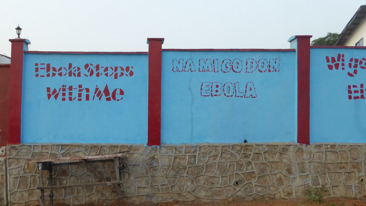 Ebola prevention messages painted on to a wall in Freetown, Sierra Leone.