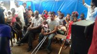 A Handicap International, ebola risk awareness session, delivered to give local redidents they need to minimize the risk of infection. Sierra Leone.; }}