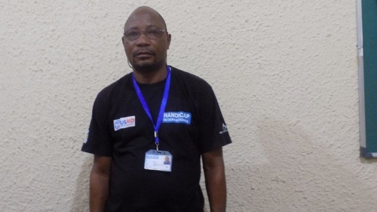 Sulu Bellarmin, who works as a driver and logistics assistant for Handicap International's team in Kasai, DR Congo.; }}