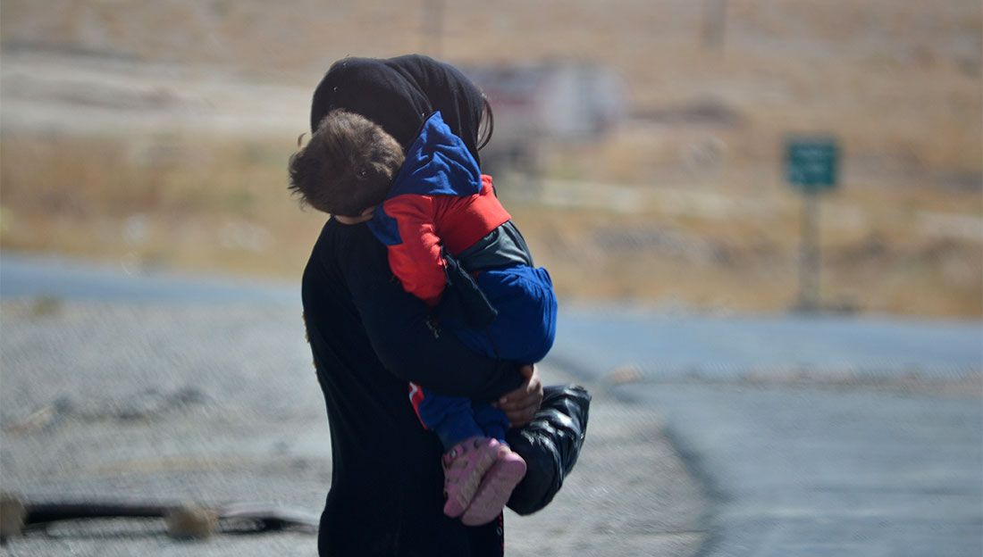 Mother and child in internally displaced persons' camp in Syria.