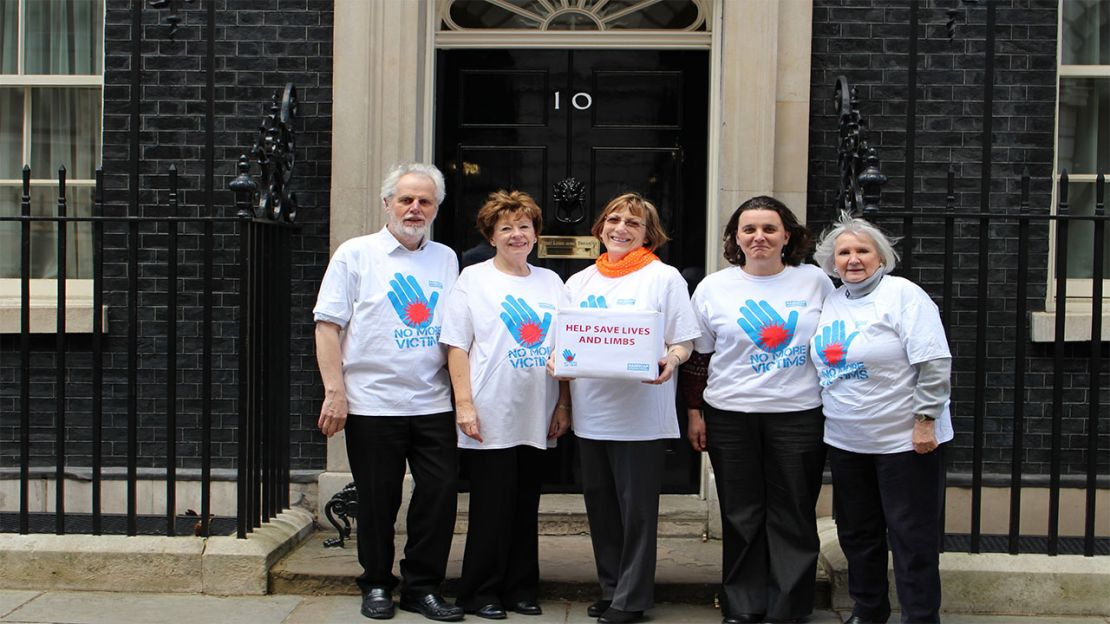 Campaigners at Downing Street (from left to right):  Martin Shirley of South Somerset Peace Group, Cathy Cotteridge, President of SI London Anglia, Barbara Brown of SI Darlington, Beatrice Cami, Head of Fundraising and Communication at Handicap International UK, and Heather Knott of SI Chelmsford.