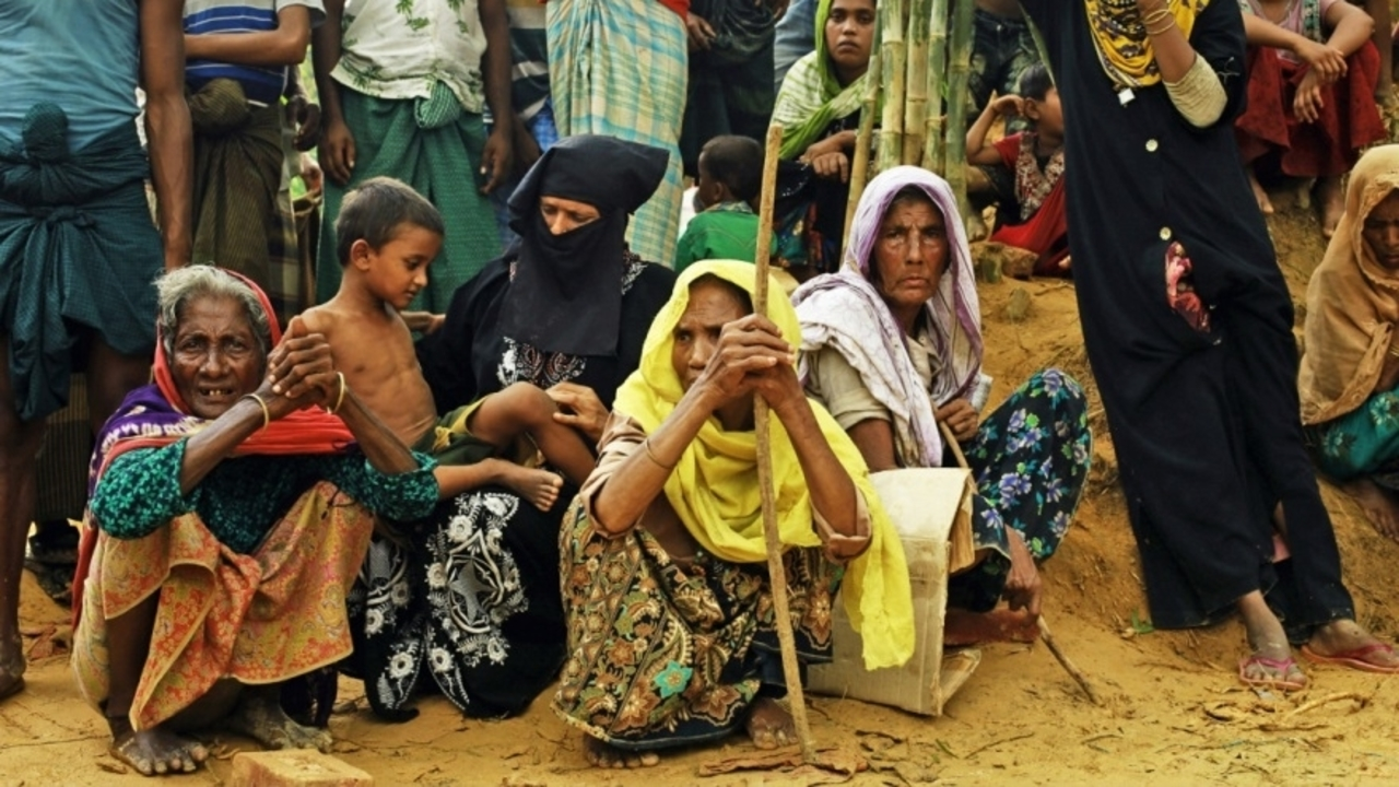 Women in a refugee camp waiting for food aid