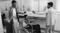 CALP hospital, Sana'a, in March 2017: Rehabilitation session with a tetraplegic patient injured during fighting in the north of Yemen.; }}