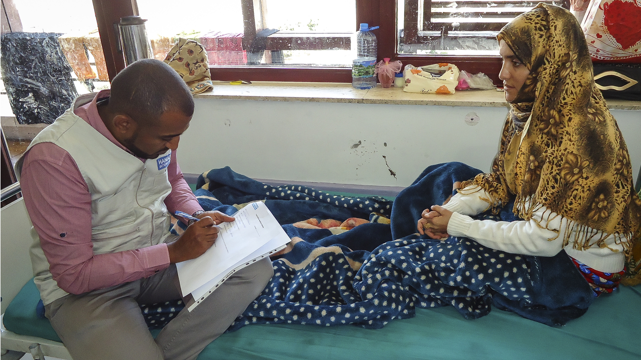 Bushra, 24, on her bed in Al Thawra hospital, Sana,'a. Injured after a bombing on her hometown, she was supported by Handicap International.