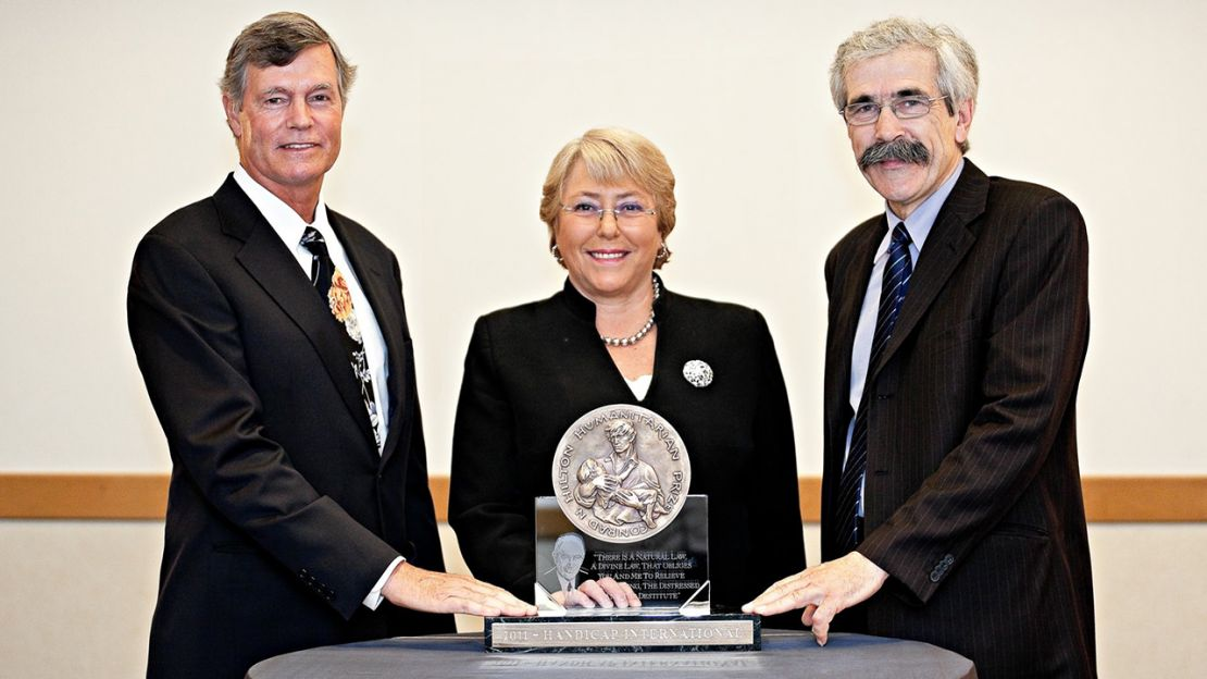 HI founder Jean-Baptiste Richardier (right) receiving the 2011 Hilton Humanitiarian Prize.