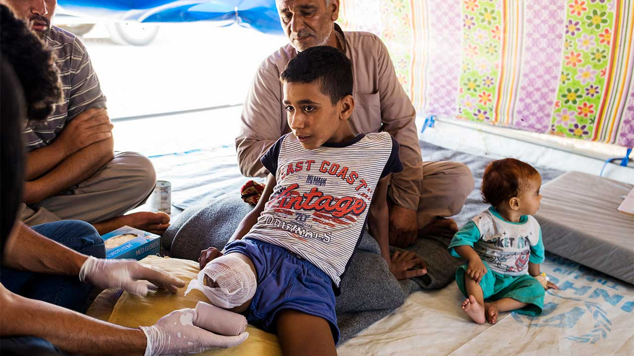 Abdel Rahman, 12, had his leg amputated after a shell exploded on his house. He is receiving care from an HI physiotherapist.