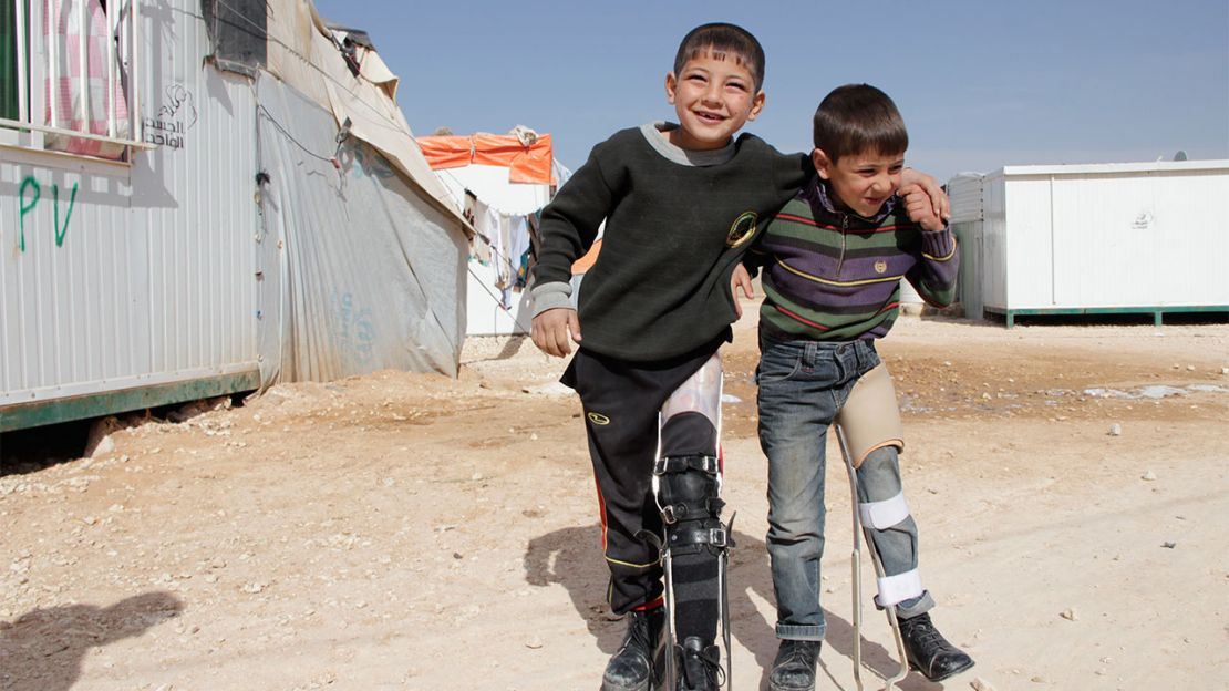 Mahmoud (left), 7, can now play outside again thanks to his orthosis.