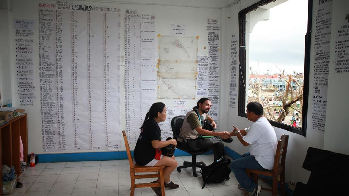Sylvian Riccio, a member of HI's emergency team, meeting local representatives at the town hall in Guiuan to establish the needs in the area. Behind them, a list of casualties and missing people covers the walls. The south coast of Samar and Eastern Samar provinces in the Philippines were severely hit by Typhoon Haiyan.